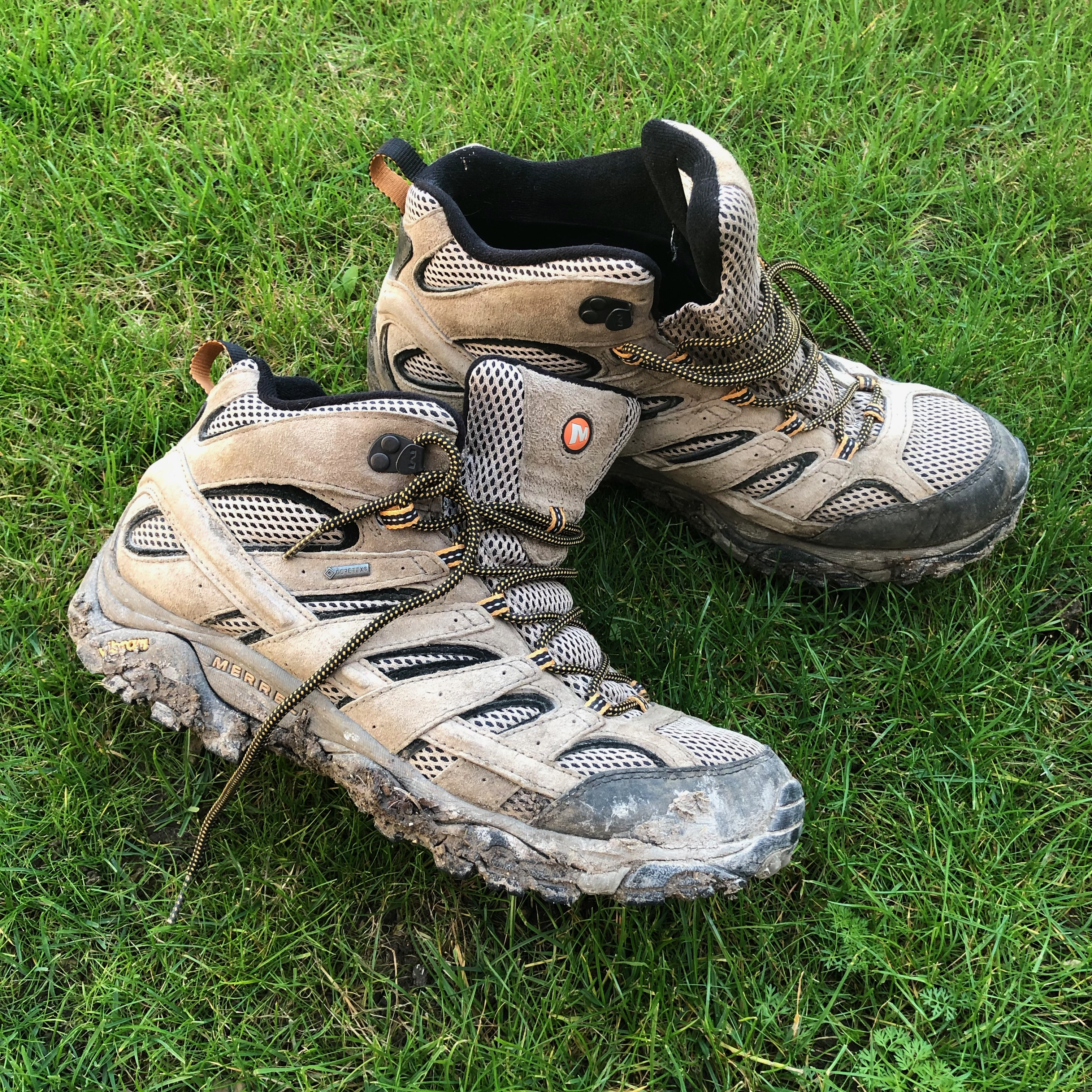 mud covered Merrell moab 2 gore-tex hiking boots